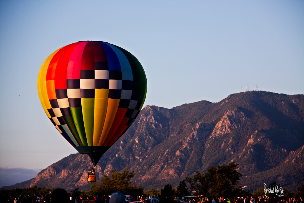 cheyenne mountain as the backdrop for this colorful balloon