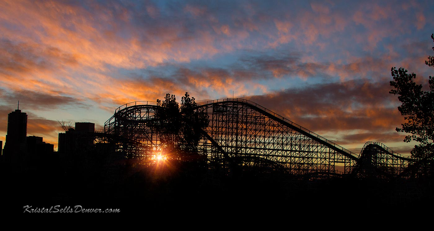 A sunburst shines through the roller coaster at Eliches